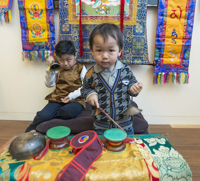 Children were invited to try on traditional Tibetan clothing.